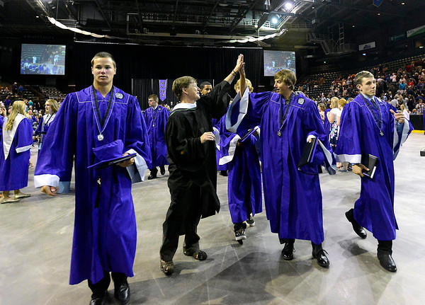 Mountain View graduate Calvin Bonar gives a high-five to teacher Toni Berry after his commencement ceremony at the Budwieser Events Center at The Ranch in Loveland on Saturday, May 25, 2013.