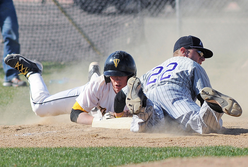 Mountain View High School third baseman Derek Neeper, right, tags out Thompson Valley's Max Schoen on a steal attempt in the bottom of the second inning of their game Tuesday at Constantz Field. The Mountain Lions won in five innings, 10-0.