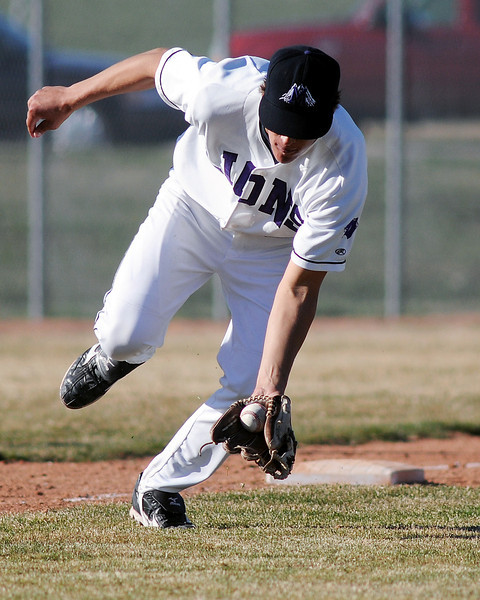 Mountain View High School third baseman Danny Netzel fields a ground ball in the top of the fifth inning of a game against Skyline on Thursday, April 8, 2010 at MVHS.
