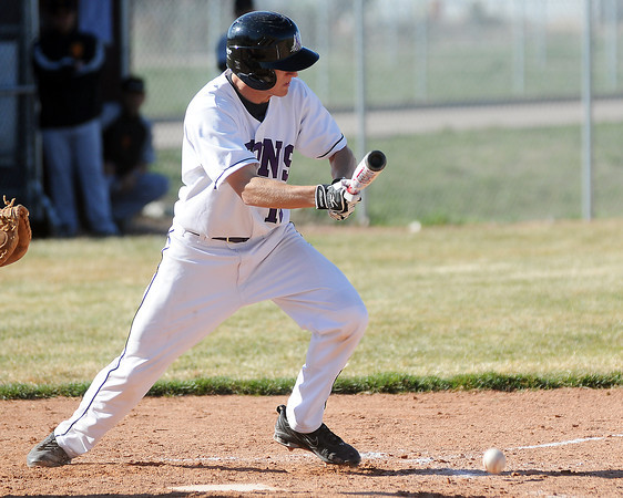 Mountain View High School's Keeton Krause lays down a bunt during a game against Skyline on Thursday, April 8, 2010 at MVHS.