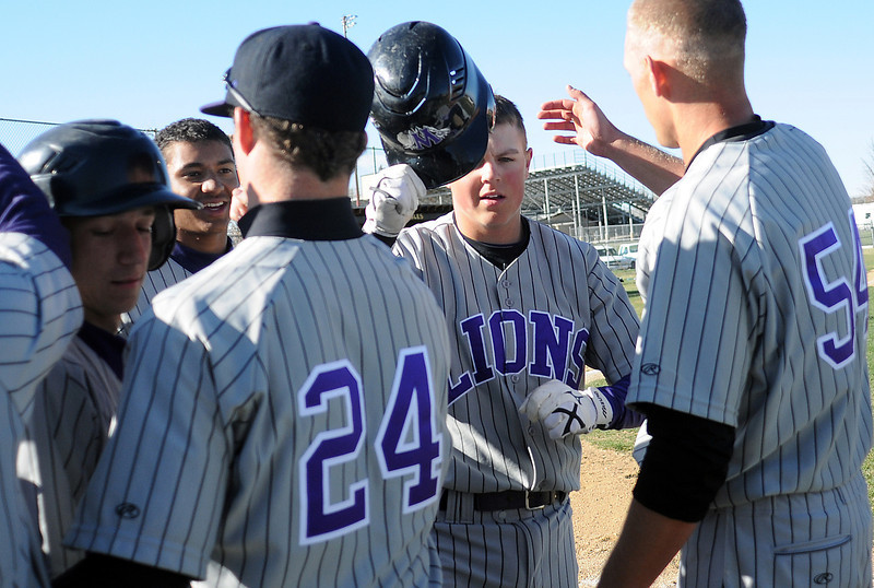 Mountain View High School sophomore Brandon Baeckel is congratulated by teammates after hitting a home run in the top of the fifth inning of a game against Thompson Valley on Tuesday at Constantz Field. The Mountain Lions won in five innings, 10-0.