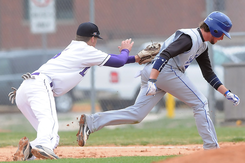 Mountain View High School shortstop Danny Netzel, left, tags out  Longmont base runner Hunter Pickett on a pickle play in the top of the third inning of their game Saturday at Brock Field.