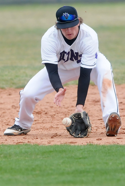 Mountain View High School second baseman Keeton Krause fields a ground ball in the top of the third inning of a game against Longmont on Saturday at Brock Field. The Mountain Lions lost, 7-3.