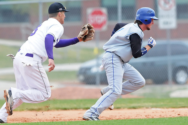Mountain View High School shortstop Danny Netzel, left, tracks down Longmont base runner Hunter Pickett before tagging him out on a pickle play in the top of the third inning of their game Saturday at Brock Field.