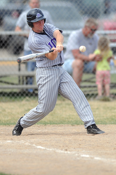 Mountain View High School's Tanner Stark swings at a pitch as he hits a home run in the top of the fifth inning of a game against Thompson Valley on Saturday, March 31, 2012 at Constantz Field.