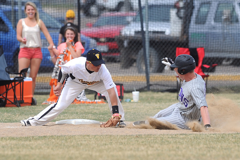 Thompson Valley High School third baseman tags out Mountain View baserunner Thomas McDaniel as he attempts to steal third in the top of the fourth inning of their game Saturday, March 31, 2012 at Constantz Field.