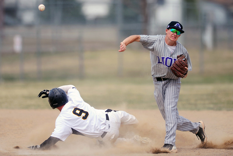 Mountain View High School shortstop Brady Starck throws to first base to complete a double play after getting the force out at second on Thompson Valley baserunner Kyle Kelly in the bottom of the fourth inning of their game Saturday, March 31, 2012 at Constantz Field.