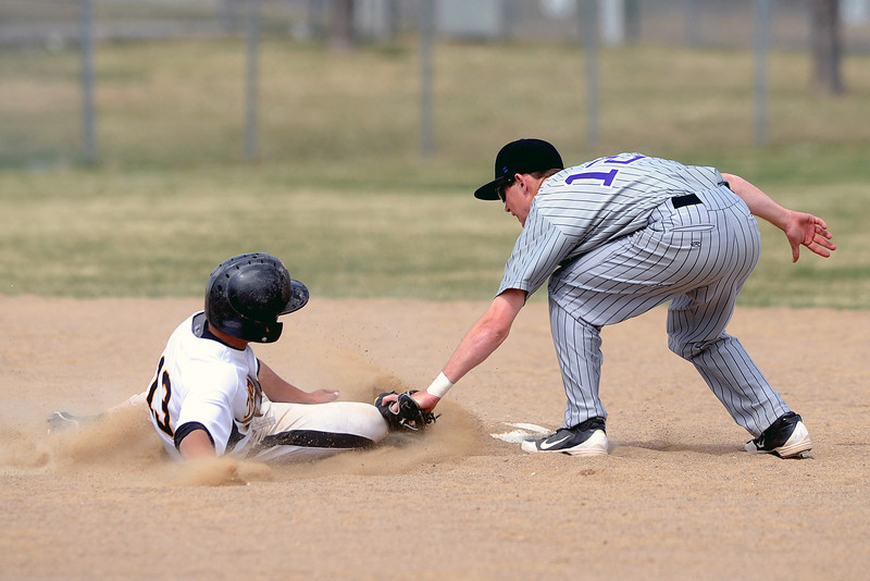 Mountain View High School second baseman Max Moree tags out Thompson Valley pinch runner Trevon Yep as he attempts to steal second in the bottom of the fifth inning of their game Saturday, March 31, 2012 at Constantz Field.