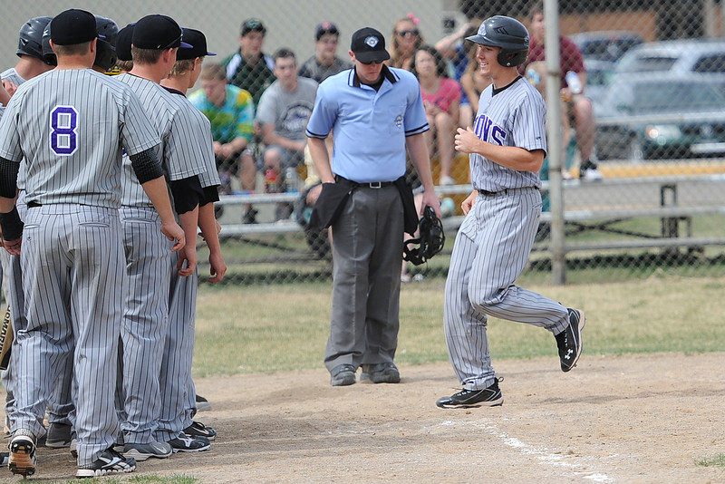 Mountain View High School's Tanner Stark, right, is congratulated by teammates at home plate after hitting a home run in the top of the fifth inning of a game against Thompson Valley on Saturday, March 31, 2012 at Constantz Field.