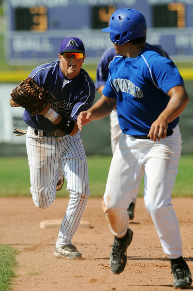 8 of Johnson's Corner runs down 14 of Broomfield during the top of the 4th inning of Thursday afternoon's game at Mountian View High School. Johnson's Corner won the game 12-8.