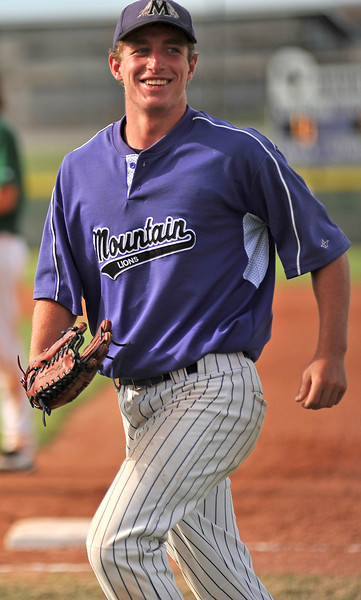 Mountain Lions' Joey Hlushak smiles while jogging in from right field Sunday after catching a pop-fly for the third out during their game against Johnson's Corner at Mountain View High School.