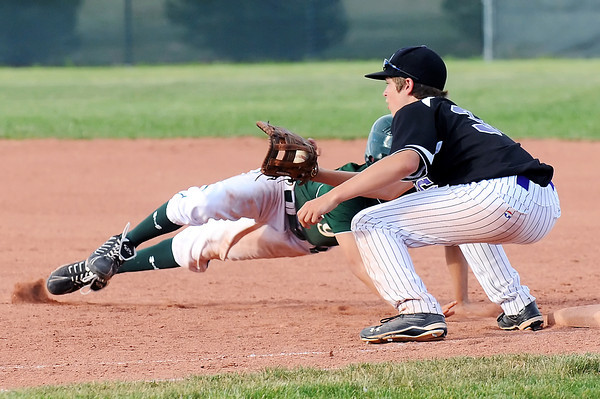 Johnson's Corner first baseman Hunter Porterfield puts the tag on Fossil Ridge High School's Clay Brundage for a pick off in the top of the sixth inning of their game on Tuesday, June28, 2011 at Brock Field. Johnson's Corner won, 6-1.