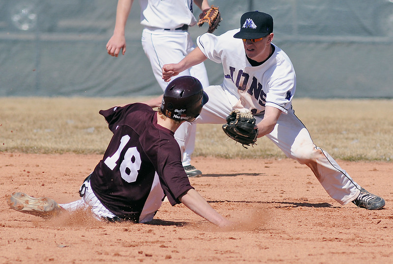 Mountain View High School second baseman Keeton Krause puts the tag Berthoud's [No. 18] on an attempted steal in the top of the third inning of their game on Saturday, March 13, 2010 at MVHS. The Mountain Lions won in five innings, 11-0.