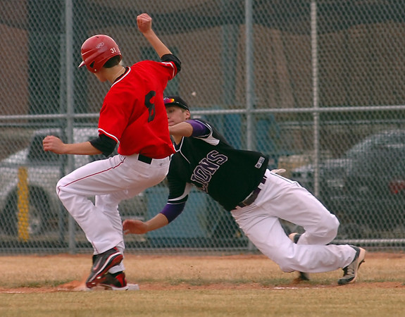 LHS #8  slides into first base as MV #5 tries to tag him out Monday during their game at Mountain View.