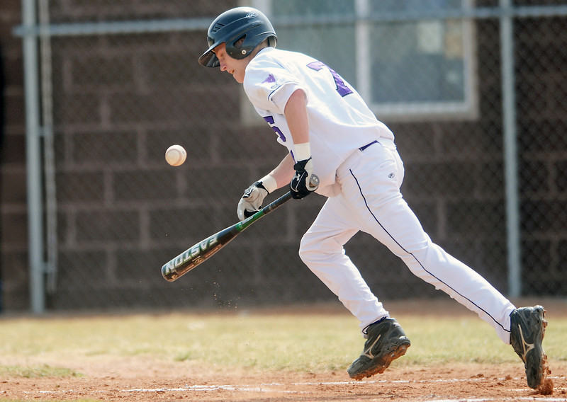 Mountain View High School sophomore Justin Dennis lays down a bunt single in the bottom of the third inning of a game against Greeley Central on Saturday at Brock Field.