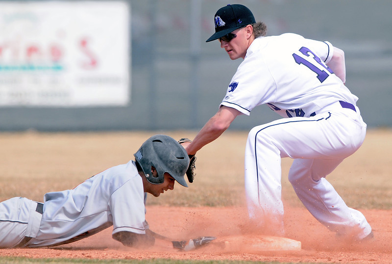 Greeley Central High School baserunner Tanner Tellez safely dives back to second base ahead of the pickoff attempt by Mountain View's Keeton Krause in the top of the fifth inning of their game Saturday at Brock Field.
