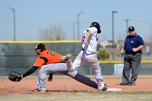 Mountain View High School's Brady Starck steps on first base for a single ahead of the throw to Greeley Central's Antonio Lopez in the bottom of the seventh inning of their game on Saturday, March 10, 2012 at MVHS.