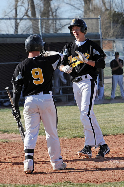 Thompson Valley High School senior Chris Sievers, right, is congratulated at home plate by teammate Kyle Kelly after hitting a home run in the top of the fourth inning of a game against Mountain View on Thursday, March 29, 2012 at Brock Field.