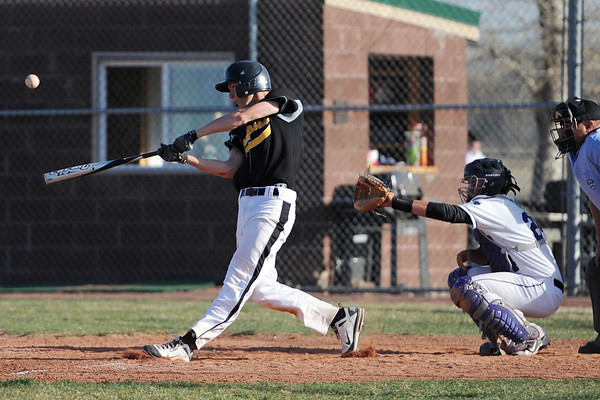 Thompson Valley High School senior Karsen Buschjost hits a single in front of Mountain View catcher Ty Porterfield in the top of the fifth inning of their game Thursday, March 29, 2012 at Brock Field.