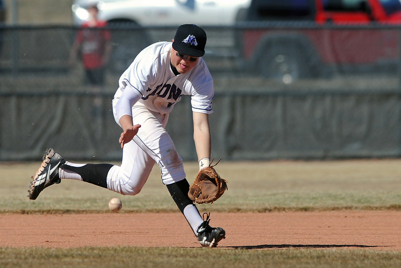 Mountain View High School third baseman Brandon Baeckel fields a ground ball in the top of the eighth inning of a game against Greeley Central on Saturday, March 10, 2012 at MVHS.