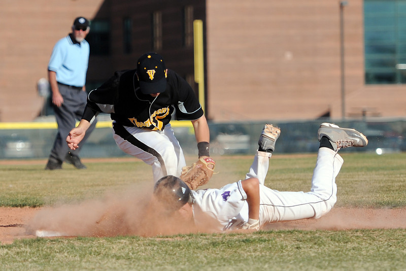 Mountain View High School baserunner Alec Suarez slides safely into second base ahead of the tag by Thompson Valley's Quaid Moore on a pick-off attempt in the bottom of the fourth inning of their game Thursday, March 29, 2012 at Brock Field.
