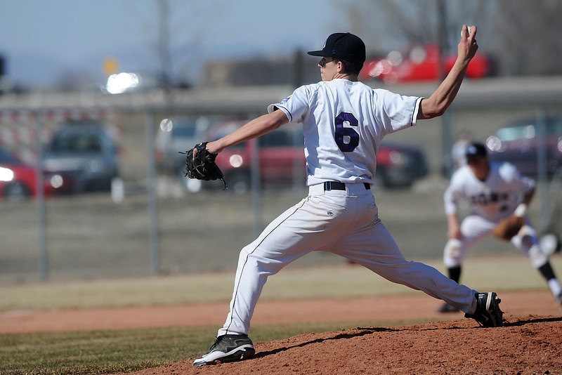Mountain View High School's Adam Baumann winds up before throwing a pitch in the top of the eighth inning of a game against Greeley Central on Saturday, March 10, 2012 at MVHS.
