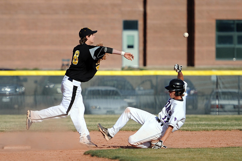 Thompson Valley High School shortstop Garrett Smith throws to first to complete a double play after getting the force out of Mountain View baserunner Kollin Evens in the bottom of the fourth inning of their game Thursday, March 29, 2012 at Brock Field.