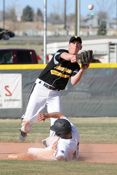 Thompson Valley High School second baseman Jeremy White throws to first base after getting the force out of Mountain View High School baserunner Max Moree in the bottom of the third inning of their game Thursday, March 29, 2012 at Brock Field.