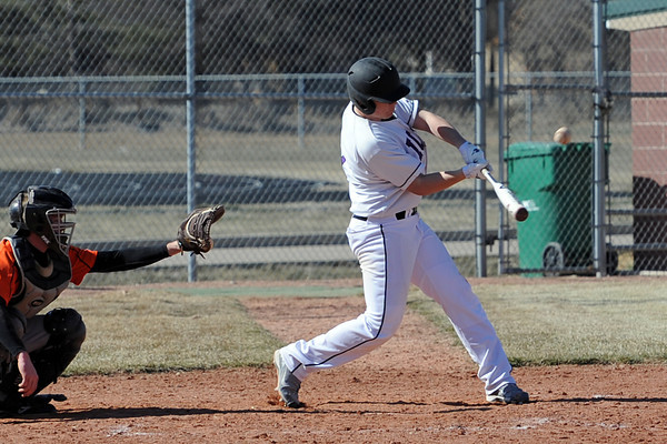 Mountain View High School's Justin Clinton connects with the ball to drive in the winning run in the bottom of the ninth inning of a game against Greeley Central on Saturday, March 10, 2012 at MVHS.