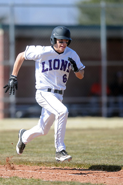 Mountain View High School's Adam Baumann sprints to first base for a single in the bottom of the third inning of a game against Greeley Central on Saturday, March 10, 2012 at MVHS.