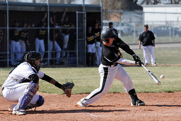 Thompson Valley High School senior Kyle Kelly hits a double as Mountain View catcher Ty Porterfield looks on in the top of the third inning of their game Thursday, March 29, 2012 at Brock Field.