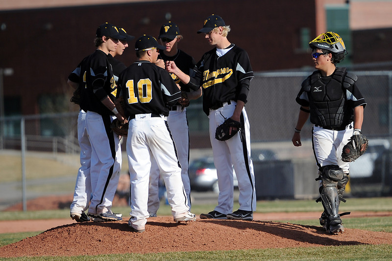 Thompson Valley High School baseball players meet on the mound during a break in the action of a game against Mountain View on Thursday, March 29, 2012 at Brock Field.