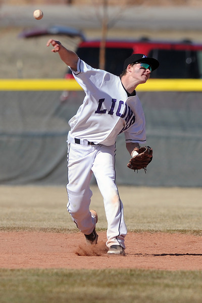 Mountain View High School shortstop Brady Starck makes the throw to first base after fielding a ground ball in the top of the ninth inning of a game against Greeley Central on Saturday, March 10, 2012 at MVHS.
