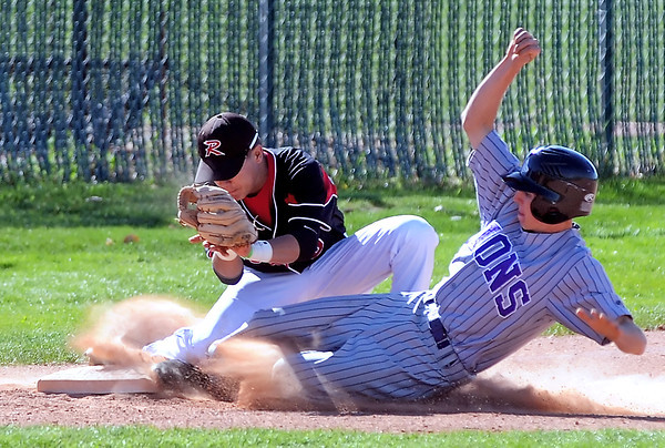 Mountain View High School's Daryl Beemer slides safely into third base for a steal under the tag attempt of Roosevelt third baseman Raul Maldonado in the top of the second inning of their game Tuesday at RoughRider Ballpark in Johnstown. The Mountain Lions won in five innings, 15-1.