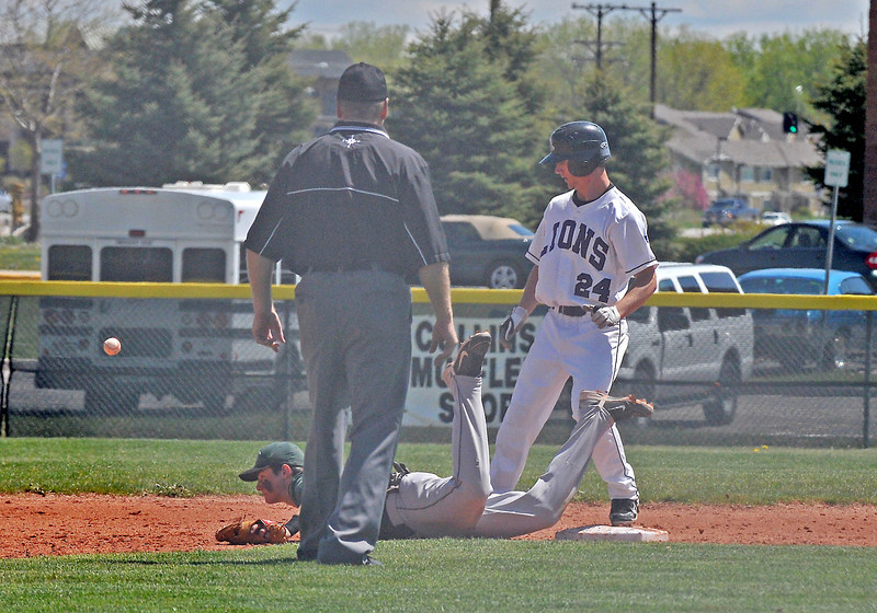 Steve Ryan, 24, narrowly misses getting tagged out at second by Conifer and manages to make it around the bases to home, in their Sunday game.