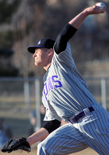 Mountain View High School senior Nick Miller throws a pitch during a game against Loveland on March 12, 2010 at Swift Field.