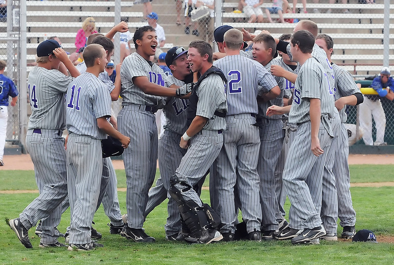 Mountain View High School's baseball team celebrates after defeating Broomfield in the Class 4A State Baseball Championship game on Saturday, May 29, 2010 at All-City Stadium in Denver. The Mountain Lions won in nine innings, 1-0.