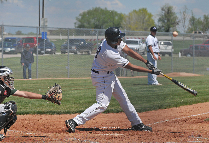 Lions player Brandon Baeckel takes a swing against Conifer during their Suday game.