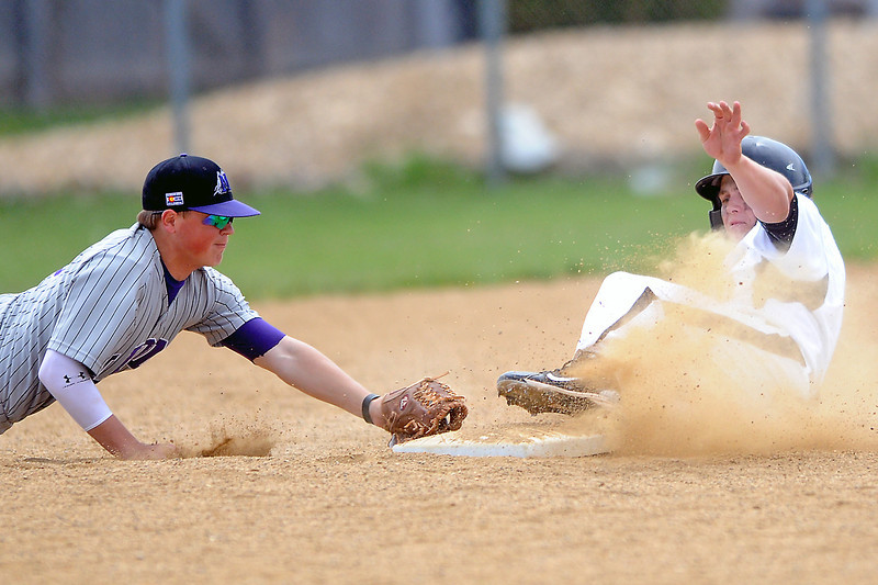 Thompson Valley High School senior Caleb Carlson, right, slides safely into second base for a double ahead of the tag by Mountain View shortstop Brandon Baeckel in the bottom of the second inning of their game on Saturday, May 7, 20111 at Constantz Field.