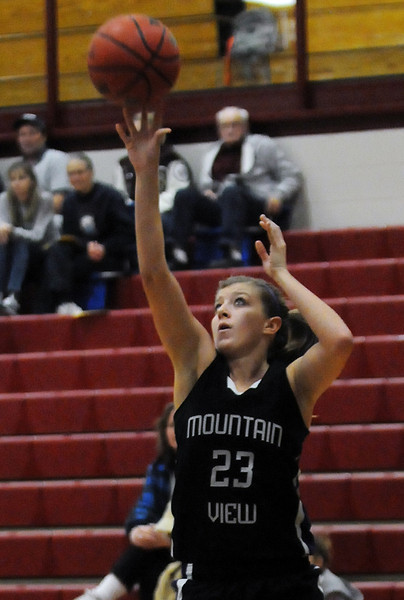 Mountain View High School's Rikelle Berry takes a shot during a game against Berthoud on Tuesday, Dec. 7, 2010 at BHS.