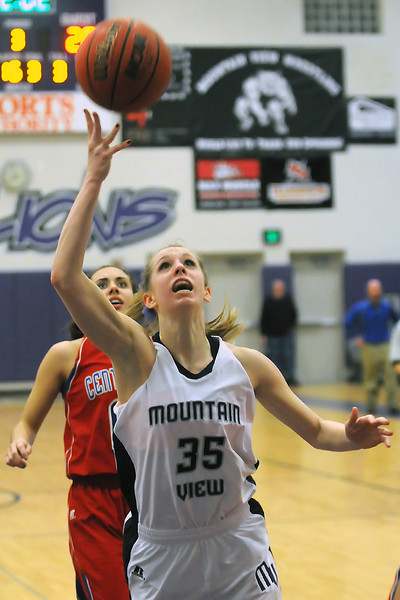 Mountain View High School senior Erin Stumbaugh (35) lays the ball up while Centaurus' Shanlie Anderson looks on in the third quarter of their game on Thursday, Feb. 10, 2011 at MVHS. The Mountian Lions won, 41-31.