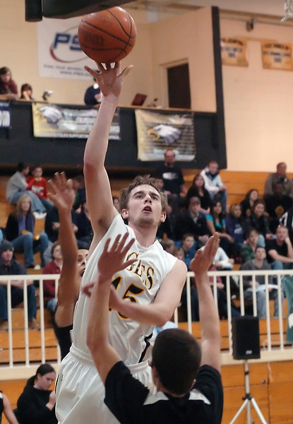 Thompson Valley High School senior Andrew Pomerleau takes a shot between Mountain View defenders Armando Garcia, back, and Brennan Stine in the first quarter of their game Friday night at TVHS.