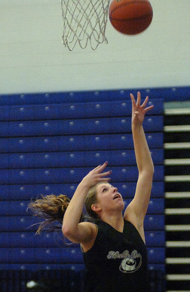 Mountain View high School basketball player Erin Stumbaugh practices Monday after school.