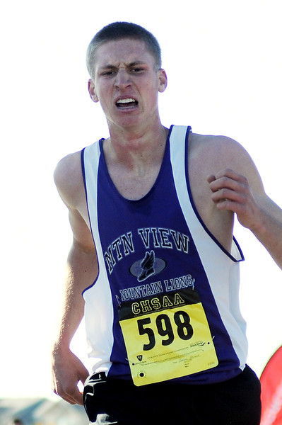Mountain View High School senior Darryl Beemer makes a final effort as he comes into the finish of the 4A State Cross Country Championships on Saturday at Fossil Ridge High School in Fort Collins.