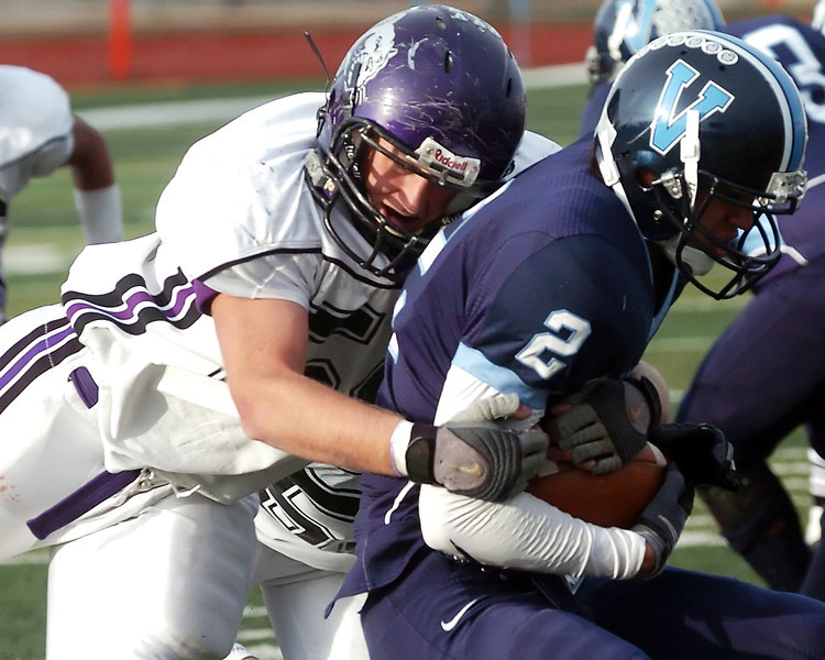 Mountain View High School senior Nick Miller tackles Valor Christian's Ryan Nu'u during their Class 3A State Football semi-final game on Saturday, Nov. 28, 2009 at Valor Stadium in Highlands Ranch. The Mountain Lions lost, 21-7.