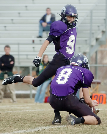 Mountain View High School senior Zach Johnson kicks an extra point while teammate Brandon Baeckel holds during a playoff game against Falcon on Saturday, Nov. 21, 2009 at Patterson Stadium.