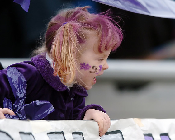 Three-year-old Hannah Stockwell cheers on her uncle, Trevor Davidsen, who wears number 53 for the Mountain View High School football team during the Mountain Lions' Class 3A state quarterfinal game against Falcon on Saturday, Nov. 21, 2009 at Patterson Stadium.