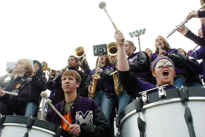 Percussionists with the Mountain View High School pep band, front from left, Blake Christensen, Dayton Cooney and Mike Grell play from the grandstand at Patterson Stadium during the Mountain Lions' Class 3A state quarterfinal game against Falcon on Saturday. Mountain View won, 39-6, and will face Valor Christian High School next week in Highlands Ranch.