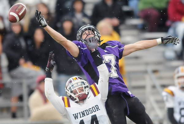 The football just misses Mountain View High School wide receiver Justin Olson's outstretched hand as he is defended on the play by Windsor's Aaron Schmidt in the third quarter of their game Saturday at Patterson Stadium. Mountian View lost, 14-0.