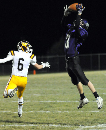 Nick Black, right, of Mountain View High School nearly intercepts a ball intended for Tanner Walker of Windsor during the first quarter of Friday night's game at Patterson Field.
